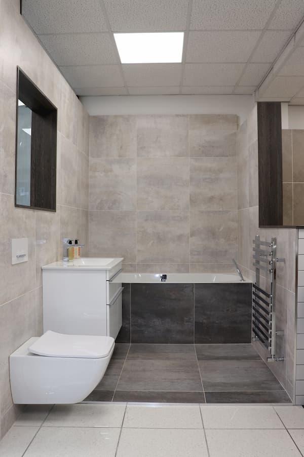 Showroom bathroom with cupboard, basin, towel rail and wc