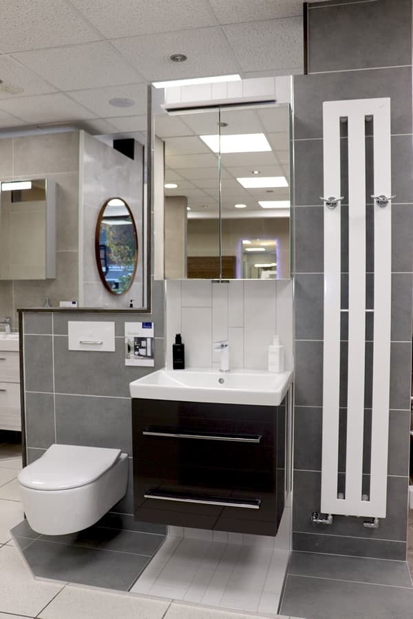 Bathroom with shower, mirror and built-in cupboard